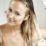 Stacy Keibler-applying-spray-John Frieda